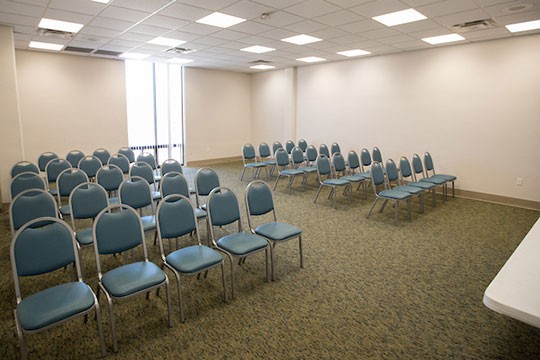 Room with chairs set on both sides